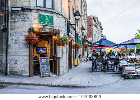 Montreal, Canada - May 27, 2017: Old Town Area With People Sitting By Street In Evening Outside Rest