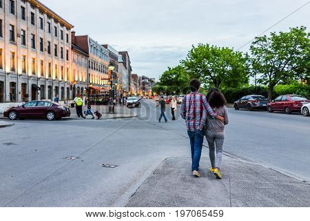 Montreal, Canada - May 27, 2017: Old Town Area With People Walking Up Street In Evening Outside Rest