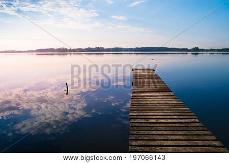 Empty footbridge over the lake Selment Wielki.