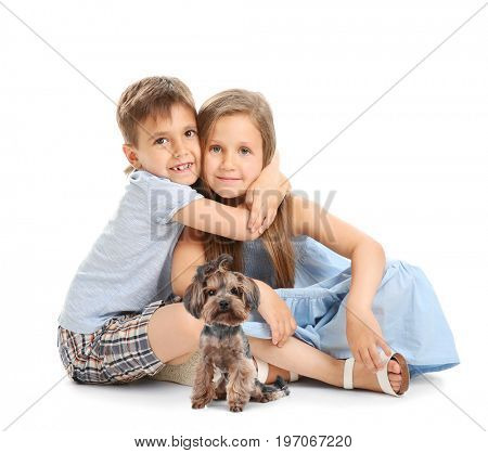 Little children with cute dog on white background