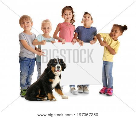 Little children holding placard and dog on white background