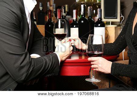 Couple tasting wine at store, closeup