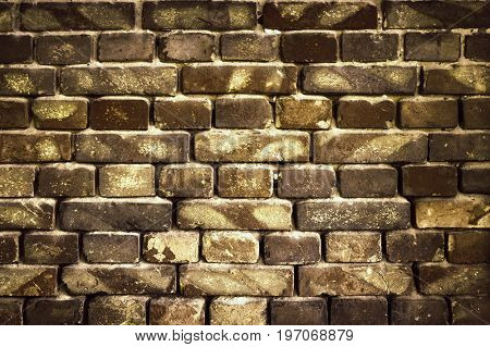 old brick wall for texture or background, dark brown toned