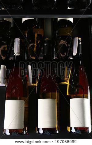 Bottles of wine on shelf at store, closeup