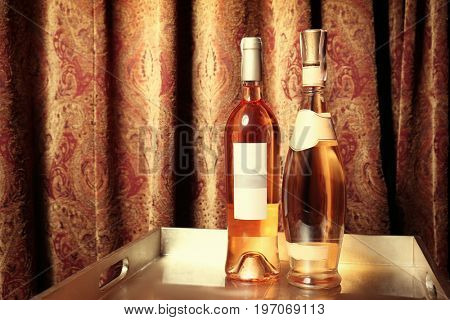 Bottles of wine on tray at store