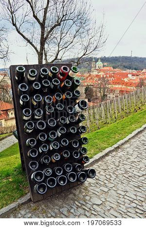 Collection sparkling wines aging in the rack outdoors against old town Prague Czech Republic