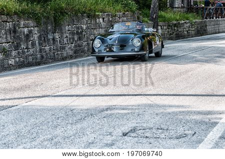 GOLA DEL FURLO, ITALY - MAY 19: PORSCHE 356 A 1500 SPEEDSTER CARRERA GT 1957 on an old racing car in rally Mille Miglia 2017 the famous italian historical race (1927-1957) on May 19 2017