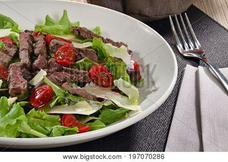 Beef steak salad dish.