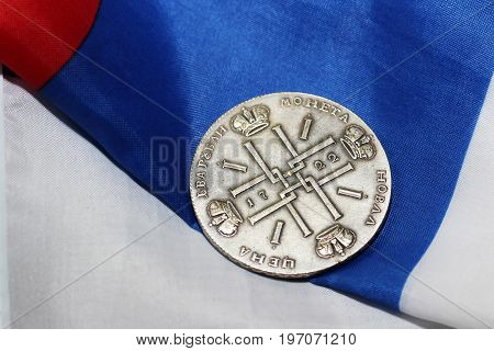 Antique Iron Coin on the russian flag, national