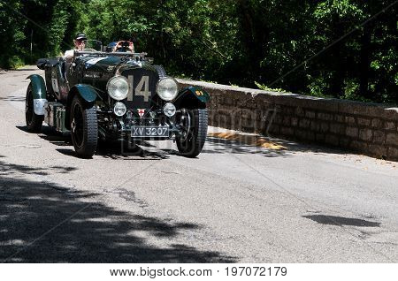 GOLA DEL FURLO, ITALY - MAY 19: BENTLEY 4,5 LITRE VANDEN PLAS 1928 on an old racing car in rally Mille Miglia 2017 the famous italian historical race (1927-1957) on May 19 2017