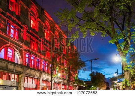 Montreal, Canada - May 27, 2017: Downtown Area With Red Building Called Monument National La Salle L