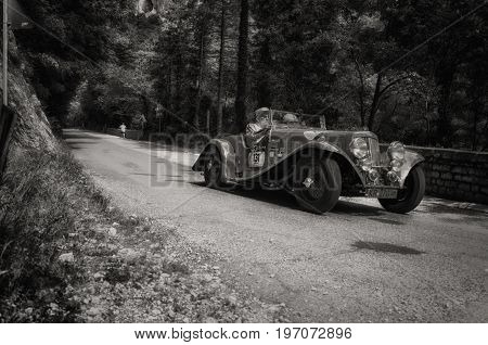 GOLA DEL FURLO, ITALY - MAY 19: ASTON MARTIN 15/98 SHORT CHASSIS 1937 on an old racing car in rally Mille Miglia 2017 the famous italian historical race (1927-1957) on May 19 2017