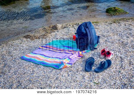 Things for the beach towel sunscreen flip flops