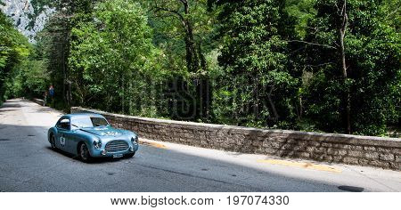 GOLA DEL FURLO, ITALY - MAY 19: CISITALIA 202 SC BERLINETTA PININ FARINA 1948 on an old racing car in rally Mille Miglia 2017 the famous italian historical race (1927-1957) on May 19 2017