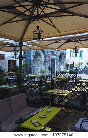 July 2017 - Kotor, Montenegro. Ancient fortress Kotor in Montenegro. Cozy cafe restaurant on the streets of the ancient town.