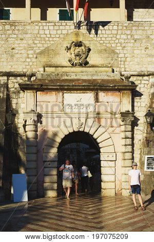 July 2017 - Kotor, Montenegro. Ancient fortress Kotor in Montenegro. Tourists and visitors of the city enter the main gate of the fortress.
