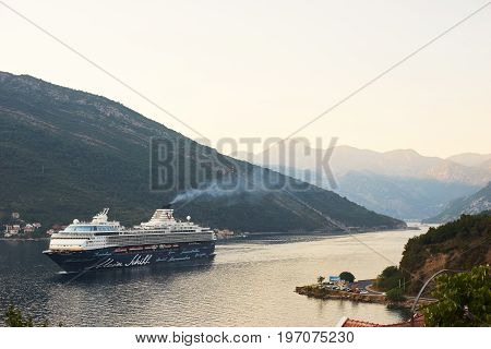July 2017, Montenegro, Tivat. Big passenger liner in the bay. Montenegro, Boka Kotorska bay on a hot summer day. Travel on a cruise liner to Montenegro.