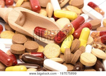 Many different pills. many different colored pills on a mirror