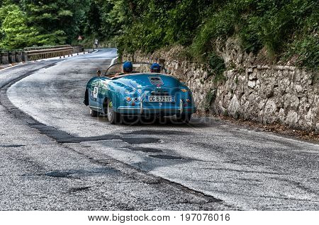 GOLA DEL FURLO, ITALY - MAY 19: PORSCHE 356 1500 SPEEDSTER 1954 on an old racing car in rally Mille Miglia 2017 the famous italian historical race (1927-1957) on May 19 2017