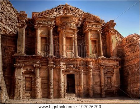 The ancient  Monastery in Petra Jordan resides in the hot desert sun.