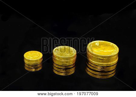 a stack of (chocolate candy) gold coins symbolizing growing wealth