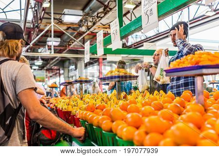 Montreal, Canada - May 28, 2017: Man Selling Produce By Fruit Stand With Sample Slices At Jean-talon