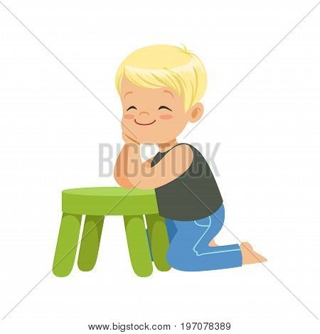 Sweet smiling little boy sitting on the floor leaning on a small green stool, colorful character vector Illustration