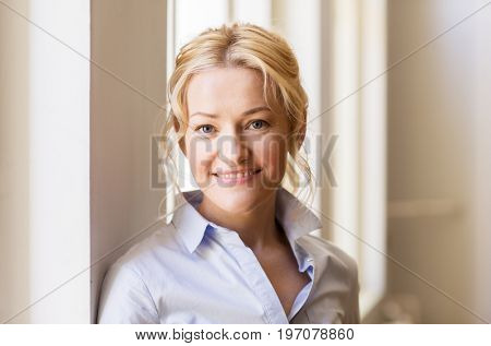 people and portrait concept - happy smiling beautiful blonde woman in shirt
