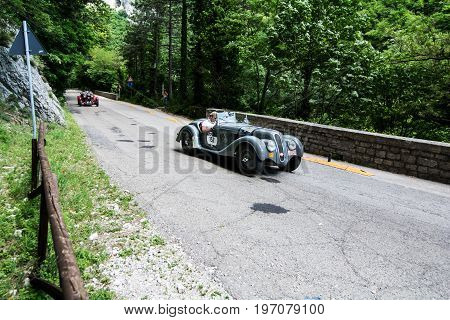 GOLA DEL FURLO, ITALY - MAY 19: BMW 328 1939 on an old racing car in rally Mille Miglia 2017 the famous italian historical race (1927-1957) on May 19 2017