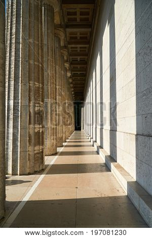 Pillars in light and shadow at walhalla, famous memorial near regensburg in bavaria, germany