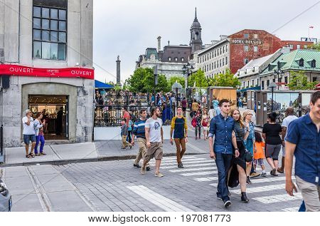 Montreal, Canada - May 27, 2017: People Crossing Road In Old Town Jacques Cartier Square Area In Cit