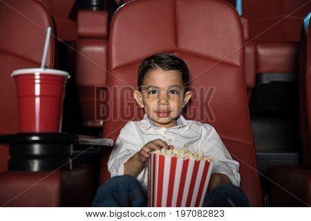 Little Boy In A Movie Theater