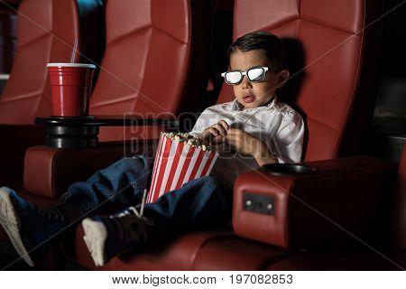 Cute Kid Watching A 3D Movie