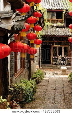 Lijiang old city Wooden architecture detail China. Yunnan province. Lijiang is famous for its UNESCO Heritage Site the Old Town of Lijiang in crowds visited by Chinese tourists