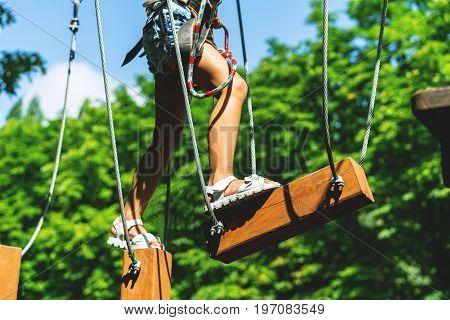 Child climbing on high rope park. adventure climbing high wire park