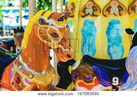 Colorful Carousel. Horses on a carnival Merry Go Round.