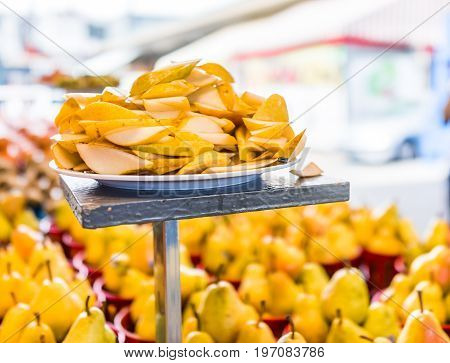 Macro Closeup Of Slices Pears Samples In Farmers Market
