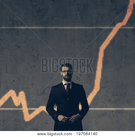 Businessman with briefcase standing over column diagram background. Business, crisis, default concept.