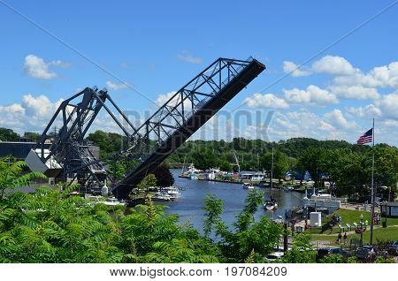 Historic Ashtabula Harbor lift bridge raised on a sunny Summer Day