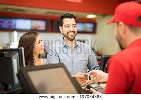 Man Buying Movie Tickets For His Girlfriend