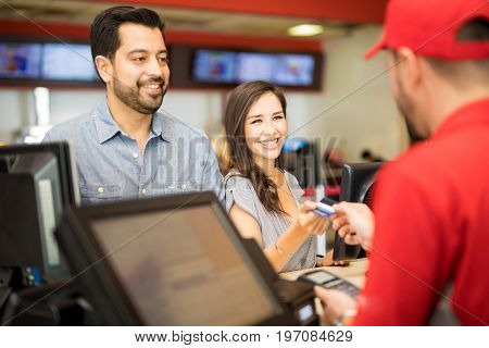 Woman Paying For Tickets On A Date