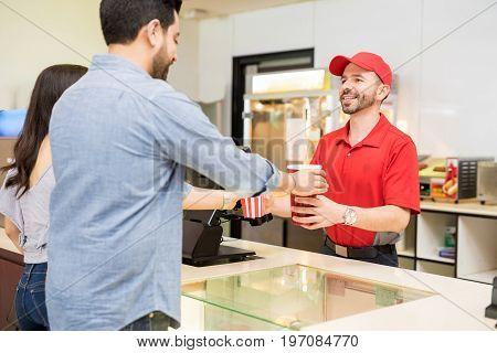 Young Couple Buying Snacks