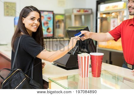 Happy Woman Buying Snacks