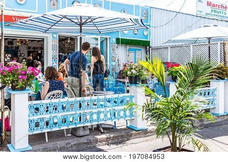 Montreal, Canada - May 28, 2017: Restaurant Outside Seating Area With People Sitting At Tables At Je