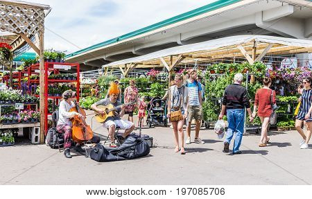 Montreal, Canada - May 28, 2017: Couple Playing Guitar And Cello By Produce Vegetable Stands Outside