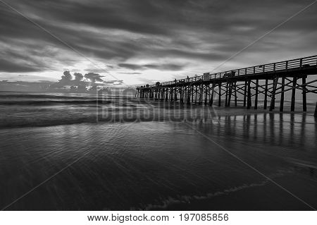 Fine art B&W of Florida coast at dawn at the pier in Flagler Beach Florida.