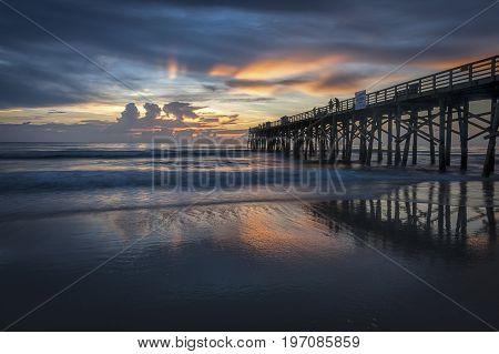Beautiful sunrise along Florida coast at the pier in Flagler Beach Florida.