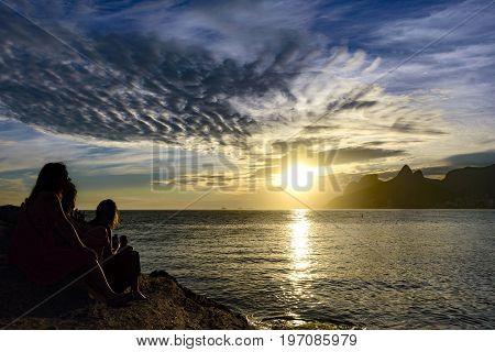 Womans silhuete at summer sunset in Ipanema beach Rio de Janeiro