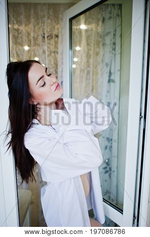 Portrait Of A Fabulous Woman In Beautiful Underwear And Shirt Posing Against The Door.