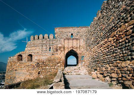 Gori, Shida Kartli Region, Georgia. Gates And Walls Of Gori Fortress. Goris Tsikhe Is A Medieval Citadel Standing Above City Of Gori On A Rocky Hill. Sunny Autumn Day With Blue Sky. Travel Destination